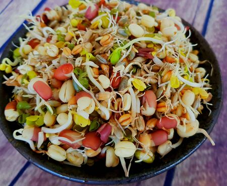 Fresh sprouted, rye, wheat, beans, radish, linseed, seed in black bowl