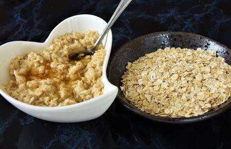 Oatmeal porridge on a black marble background Reklamní fotografie