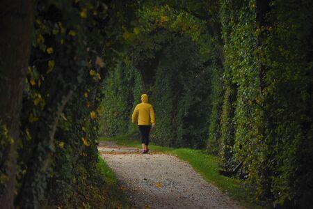 Slim woman walks along the trail outdoors