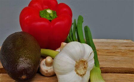 Fresh vegetables, avocado, paprika, garlic mushrooms and onions