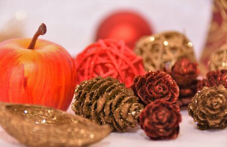 Christmas decorations, apples, cones, wicker balls on a white background