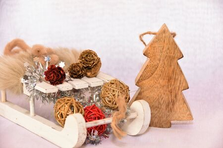 Wooden sledges and Christmas decorations on a white background Reklamní fotografie
