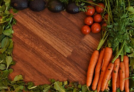 Vegetables on a wooden background for a pattern or background