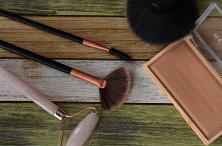 Stone stick for facial massage, brushes and makeup powder