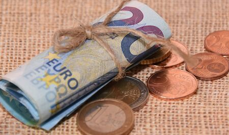Euro banknotes and coins close-up on a natural canvas