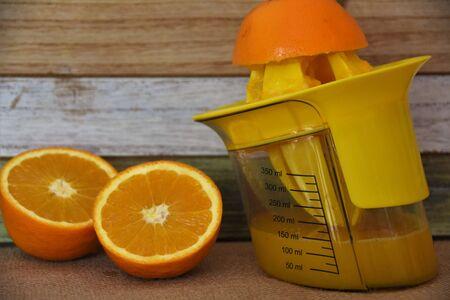 Manual citrus juice squeezer, orange and juice