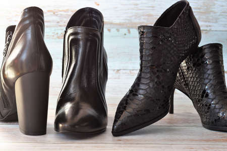 women's leather boots on a wooden floor