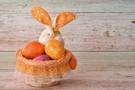 bunny with Easter eggs in a basket Stock fotó