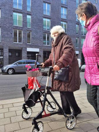 Berlin germany march 2021, elderly women with masked rollers walking down the street Sajtókép