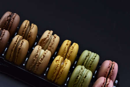 macarons multicolored on a black background Stock fotó
