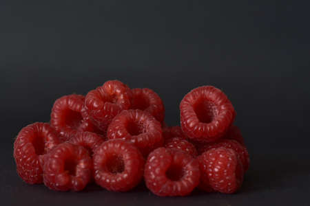 ripe raspberries on a black background Stock fotó