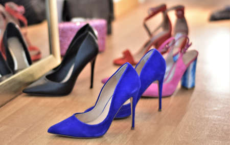 elegant high-heeled shoes stand near the mirror