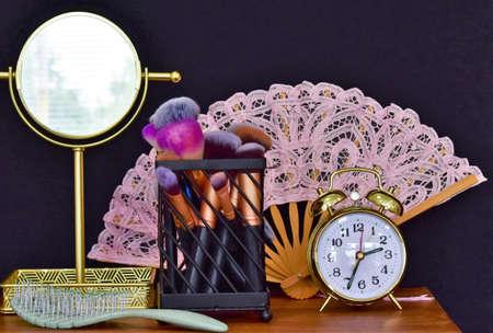 mirror, makeup brushes, comb and alarm clock