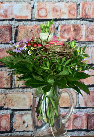 bouquet of fresh beautiful flowers on brick wall background Stock fotó