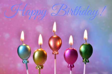 birthday greetings on the background of candles in the form of balloons