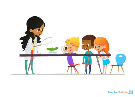 Female teacher demonstrates plant in flask, kids look through magnifier at it during botany lesson. Preschool educational activities and natural sciences education. Vector illustration for website. Çizim