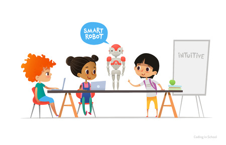Smiling children sitting at laptops around smart robot standing on table in school classroom.