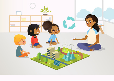 Smiling female kindergarten teacher and children sit on floor and explore toy model with renewable or sustainable energy systems, wind and solar eco friendly power stations. Vector illustration.