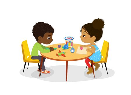 African American Boy and Girl sit at the round table and sculpt clay figures. Fine motor skills development. Sculpting activity in the art class. Poster with the Place for the text. Ilustração