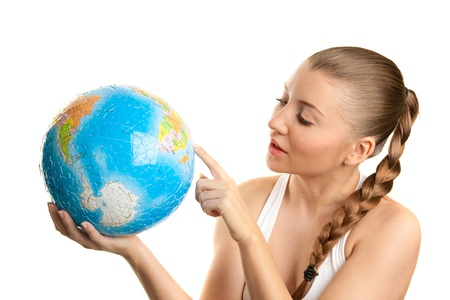 Girl searching on a globe of the world Stock Photo - 17348164