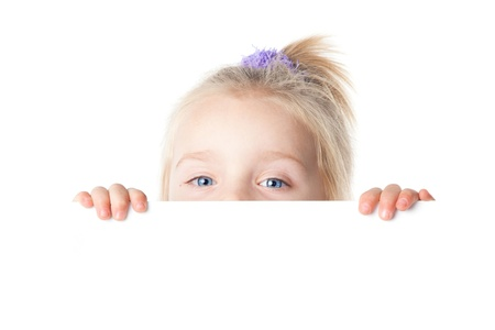 little girl looking over empty board isolated Stock Photo - 17362679