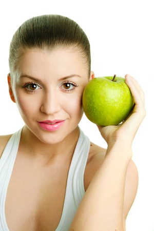 Beautiful young woman with green apple photo