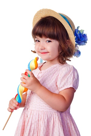 little smiling girl with lollypop