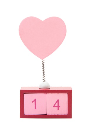 number 14: pink heart on spring over calendar showing fourteen isolated on white  Stock Photo