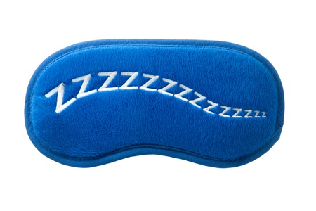 a blue satin sleep mask isolated on a white background