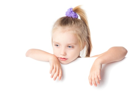 little girl looking over empty board isolated Stock Photo - 17423560