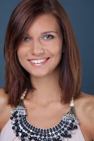 neckless: portrait of beautiful brunette girl in studio