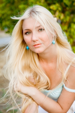 lovely beautiful blonde woman against sunny outdoor greenery Stock Photo - 17534395