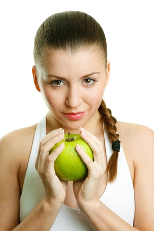 Beautiful young woman with green apple Stock Photo - 17534425