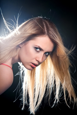 flying hair: portrait of blonde girl with flying hair