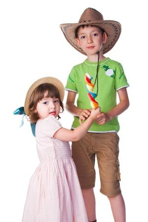 little boy and girl holding lollipop Stock Photo