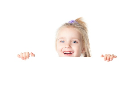happy little girl looking over empty board isolated Stock Photo - 17605540