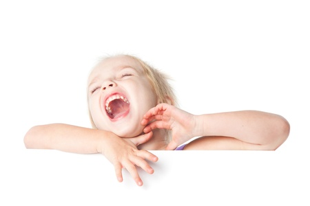 laughing little girl looking over empty board isolated Stock Photo - 17605503
