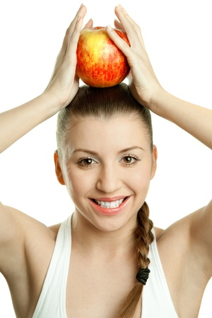 Beautiful young woman with  red apple over her head Stock Photo - 17605479