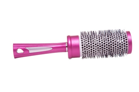 round raspberry hair brush isolated on white