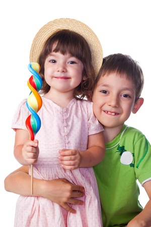 Portrait of a brother and sister  with candy photo