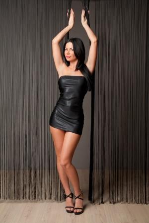 sexy brunette in short black dress