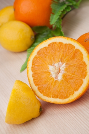 citrous: two half of fresh  lemon and orange on wooden table