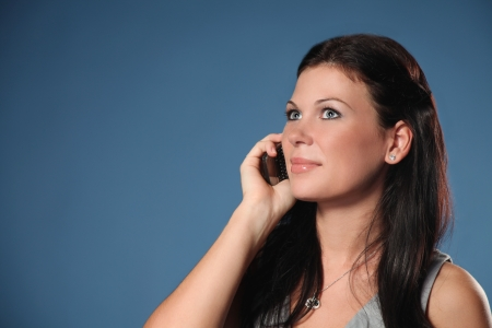 girl with cell phone over blue Stock Photo - 17785140