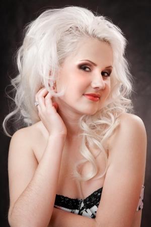 studio shot of a young, beautiful, blonde woman Stock Photo