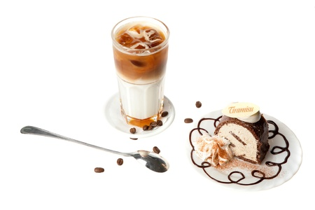 coffee cocktail with cake, spoon and beans