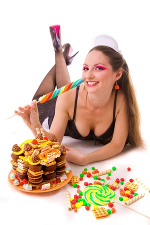 smiling girl with sweets and candies