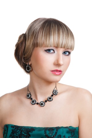 Beautiful girl in green evening dress with necklace and earrings  Stock Photo