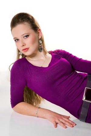 lieing: beautiful girl lieing in purple dress