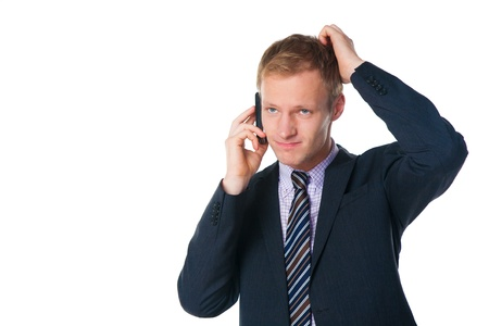 handsome businessman talking on cell phone over white