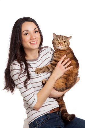 beautiful smiling brunette girl and her ginger cat over white background